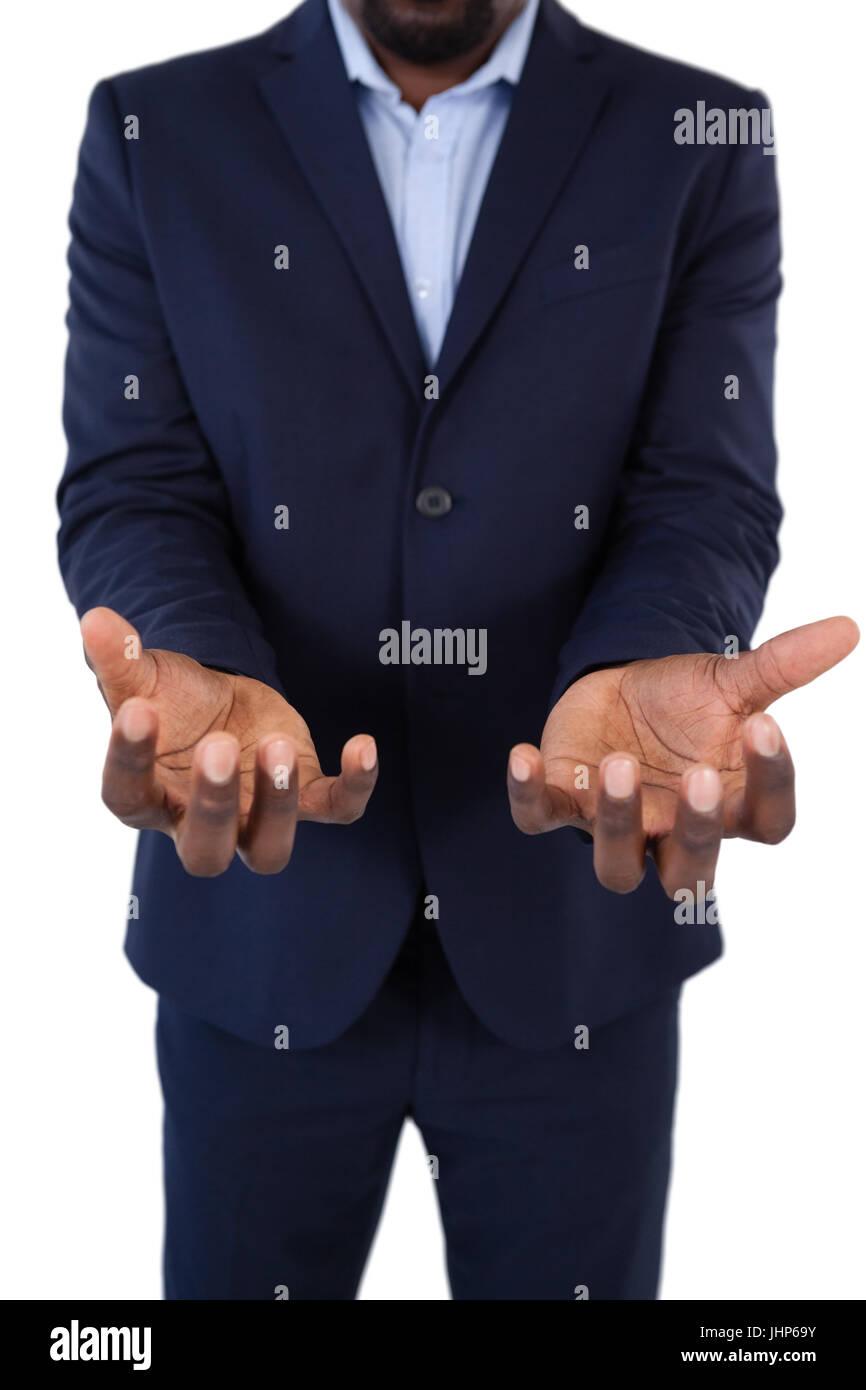 Sección intermedia de indefensos empresario mostrando sus manos Foto de stock