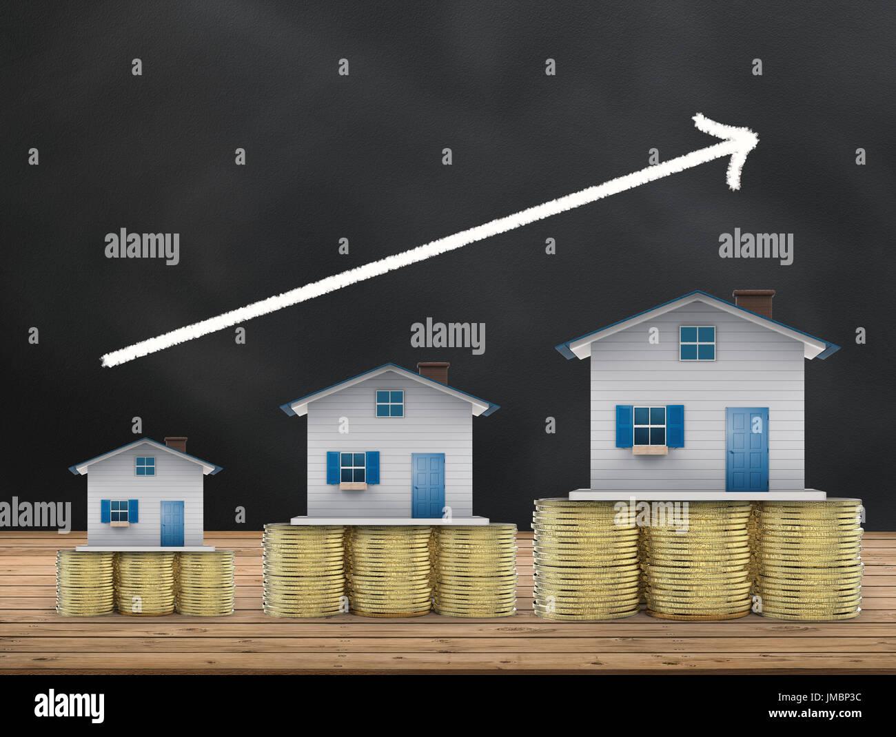 Concepto de inversión inmobiliaria con casas de maquetas y monedas de oro Imagen De Stock