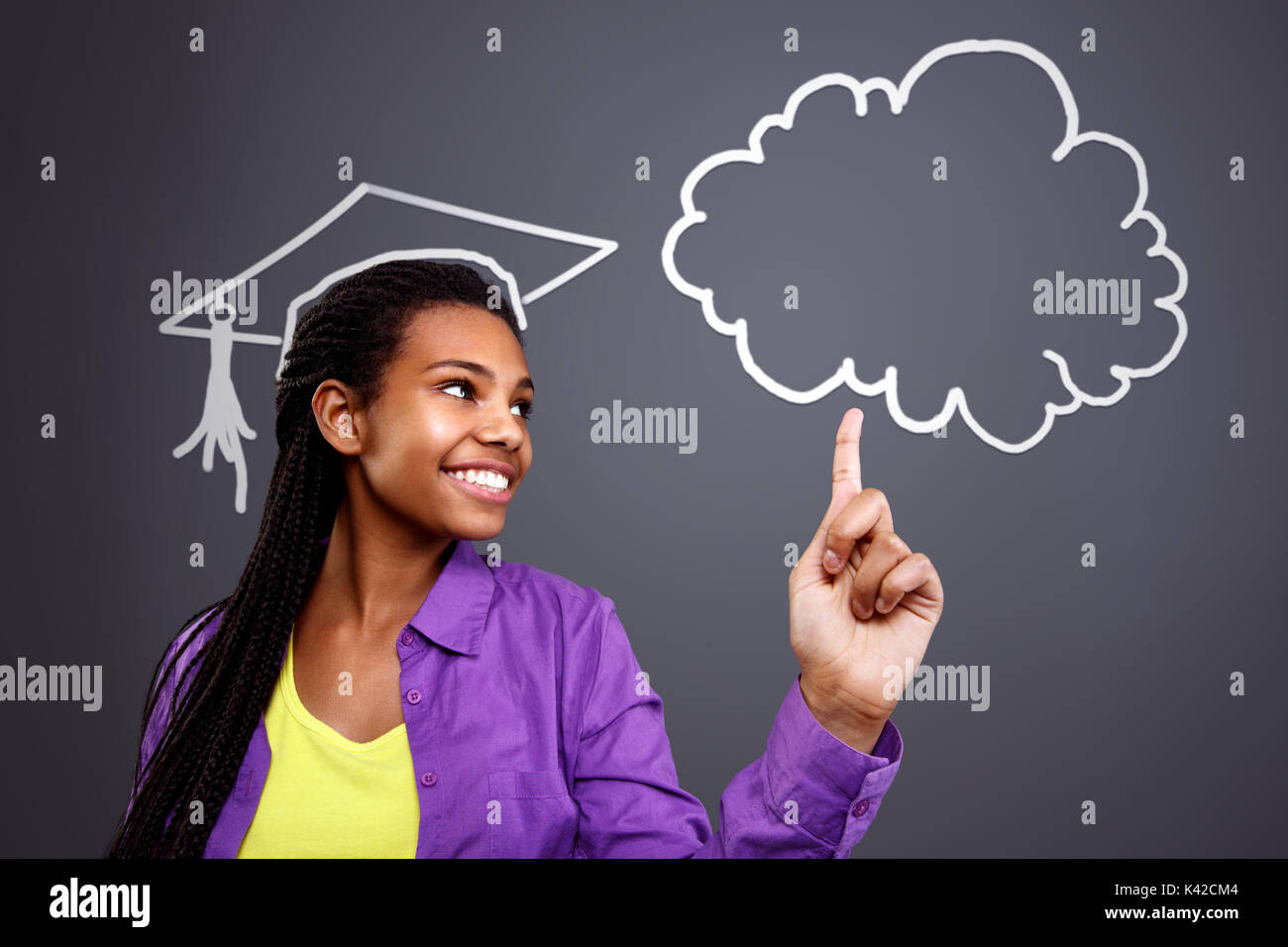 La educación en la escuela - alumna de la idea en la nube Imagen De Stock