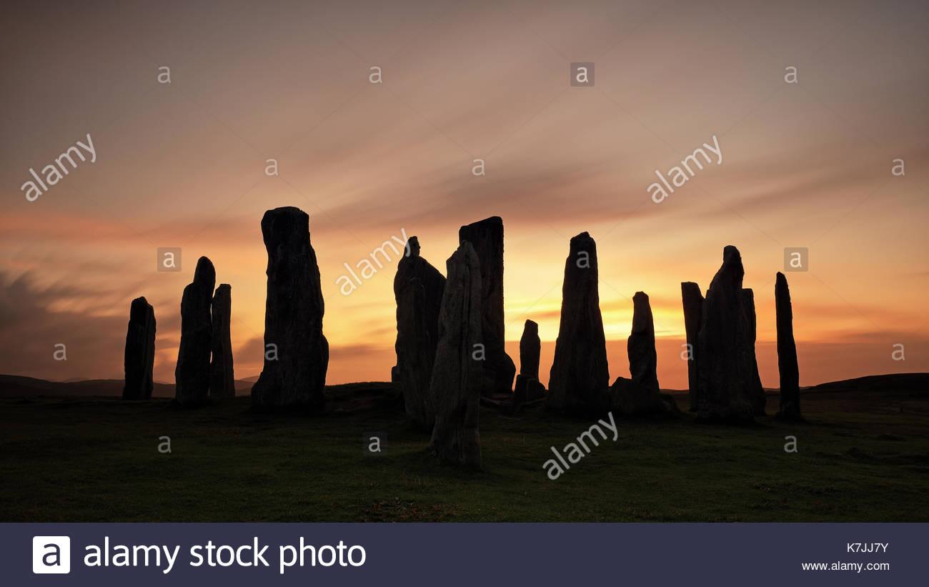 Una larga exposición grabado al atardecer de Callanish Standing Stones en la isla de Lewis, Islas Occidentales, Foto de stock