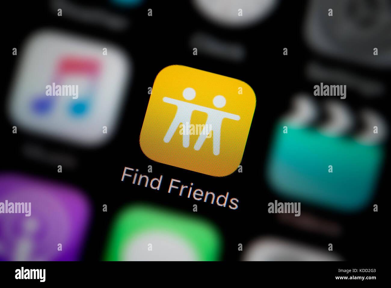 Un primer plano del logotipo que representa encontrar amigos app icono, como se ve en la pantalla de un teléfono Imagen De Stock