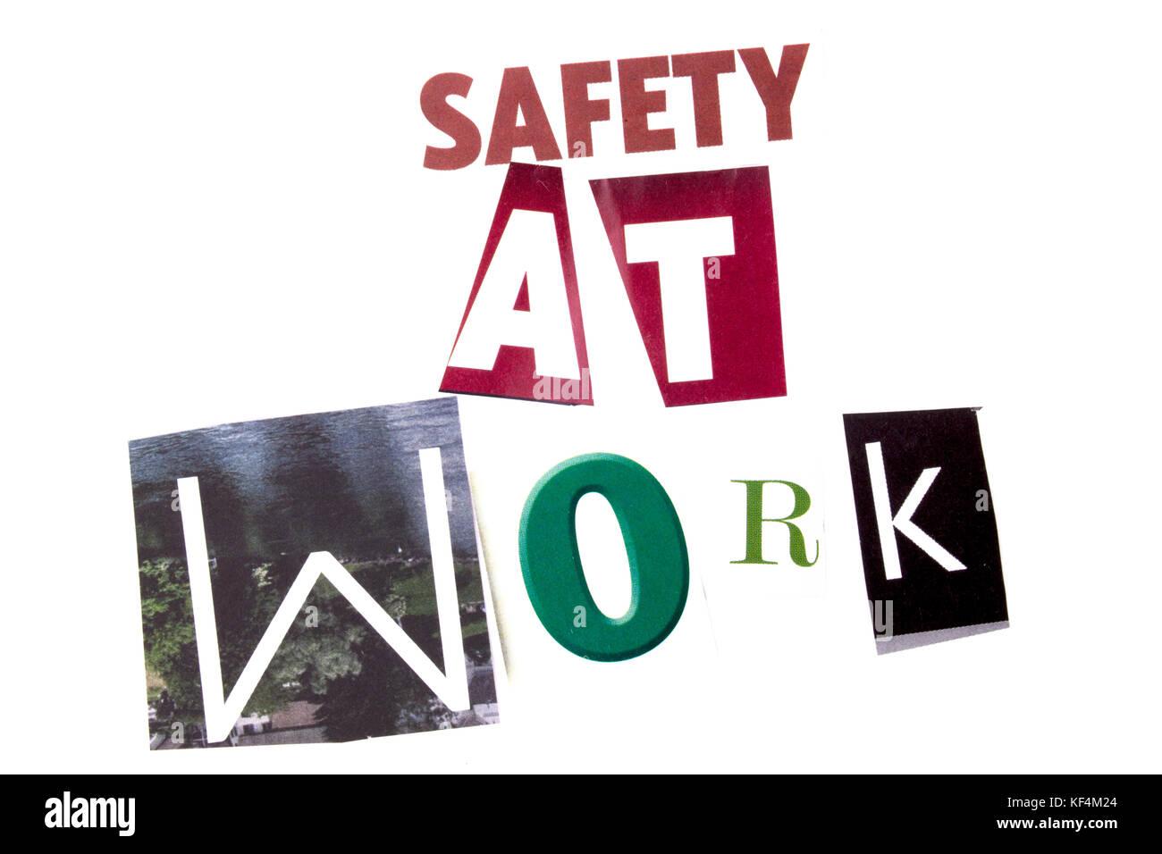Una palabra escribiendo texto mostrando el concepto de la seguridad en el trabajo realizado de diferentes periódicos revista carta por concepto de negocios sobre el fondo blanco con espacio de copia Foto de stock