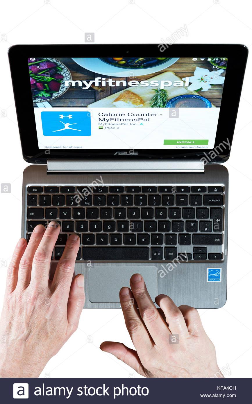 MyFitnessPal, el ejercicio y la salud app en una pantalla Chromebook con un hombre usando el teclado. Cortar sobre Imagen De Stock