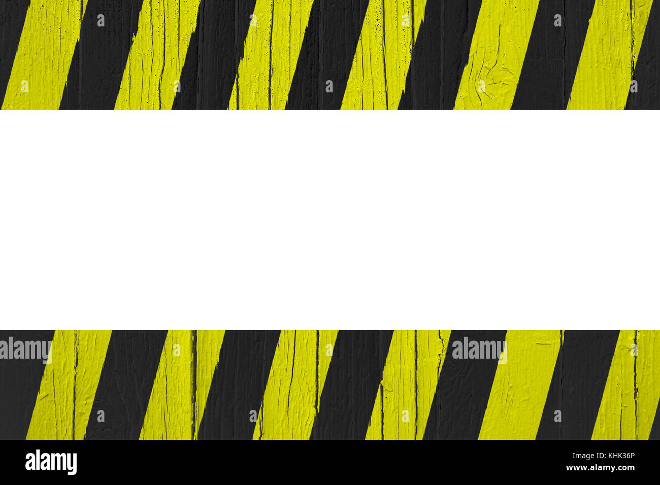 Señal de advertencia amarillo y rayas negras pintadas sobre madera ...