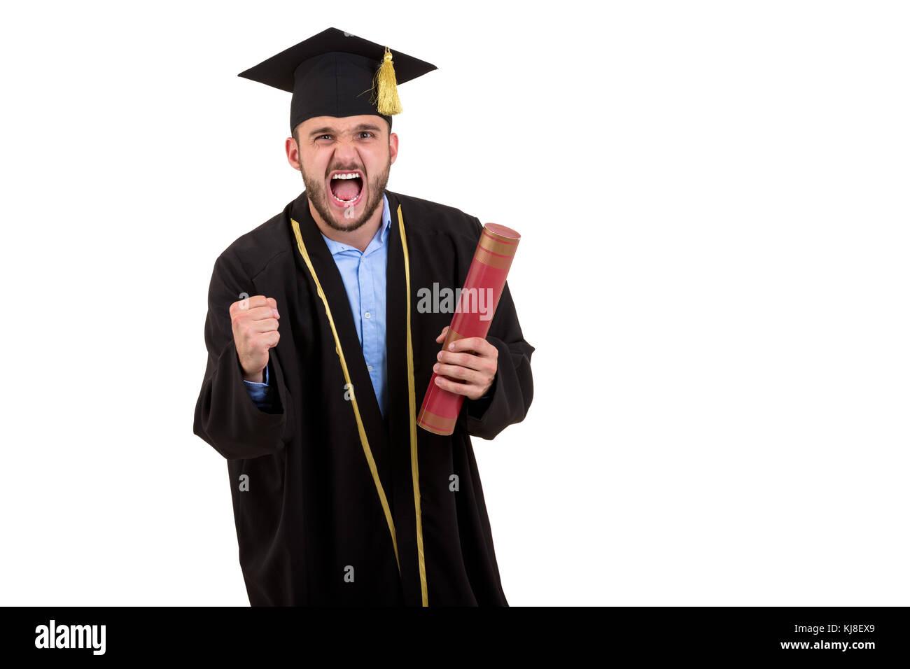 56600a68a Estudiante varón vestido de graduación en gestos con las manos aislado  sobre fondo blanco. Imagen