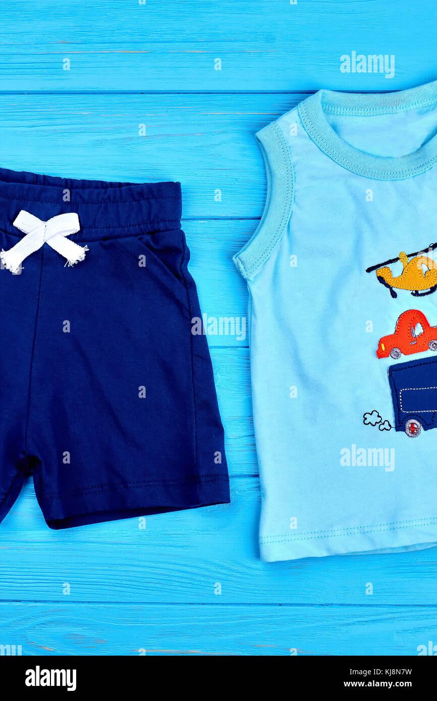 f2d511b1b Venta caliente marcas de ropa para niños pequeños. dulce diseño camiseta  sin mangas para bebé-boy, shorts, fondo de madera.