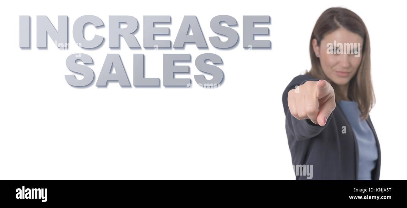 Mujer de negocios apuntando el texto aumente las ventas concepto concepto empresarial. Imagen De Stock