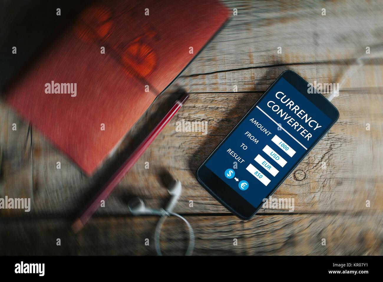 convertidor de divisas telfono mvil app en un telfono de pantalla sobre una mesa de negocios