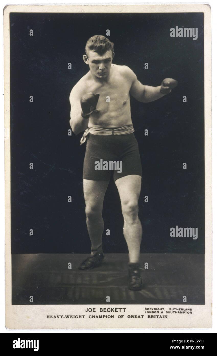Joe Beckett (1892-1965), el campeón de boxeo de peso pesado de Gran Bretaña, en la acción. Fecha: Imagen De Stock