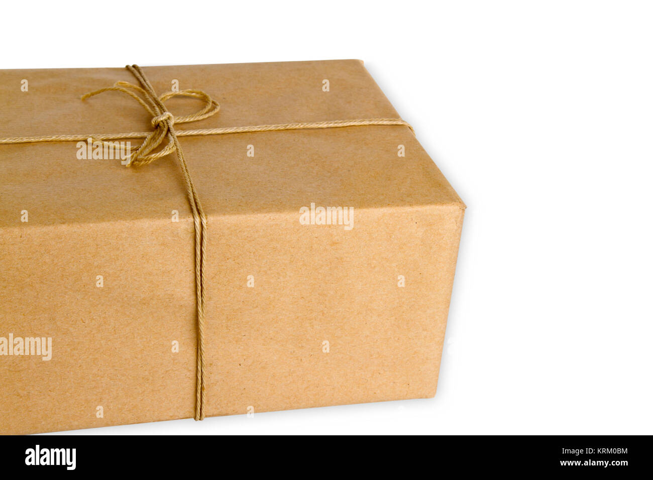 Braunes Paket freigestellt auf weissem Hintergrund Foto de stock