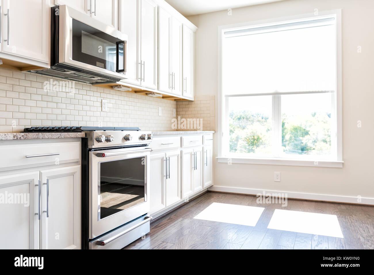 Moderna cocina neutro gris, marrón características armarios ...