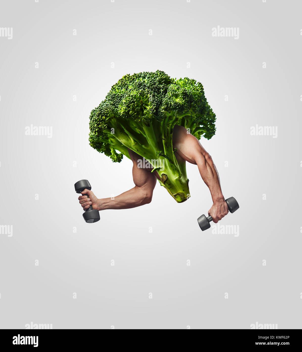 Brócoli con muscular de las manos del hombre. Imagen De Stock