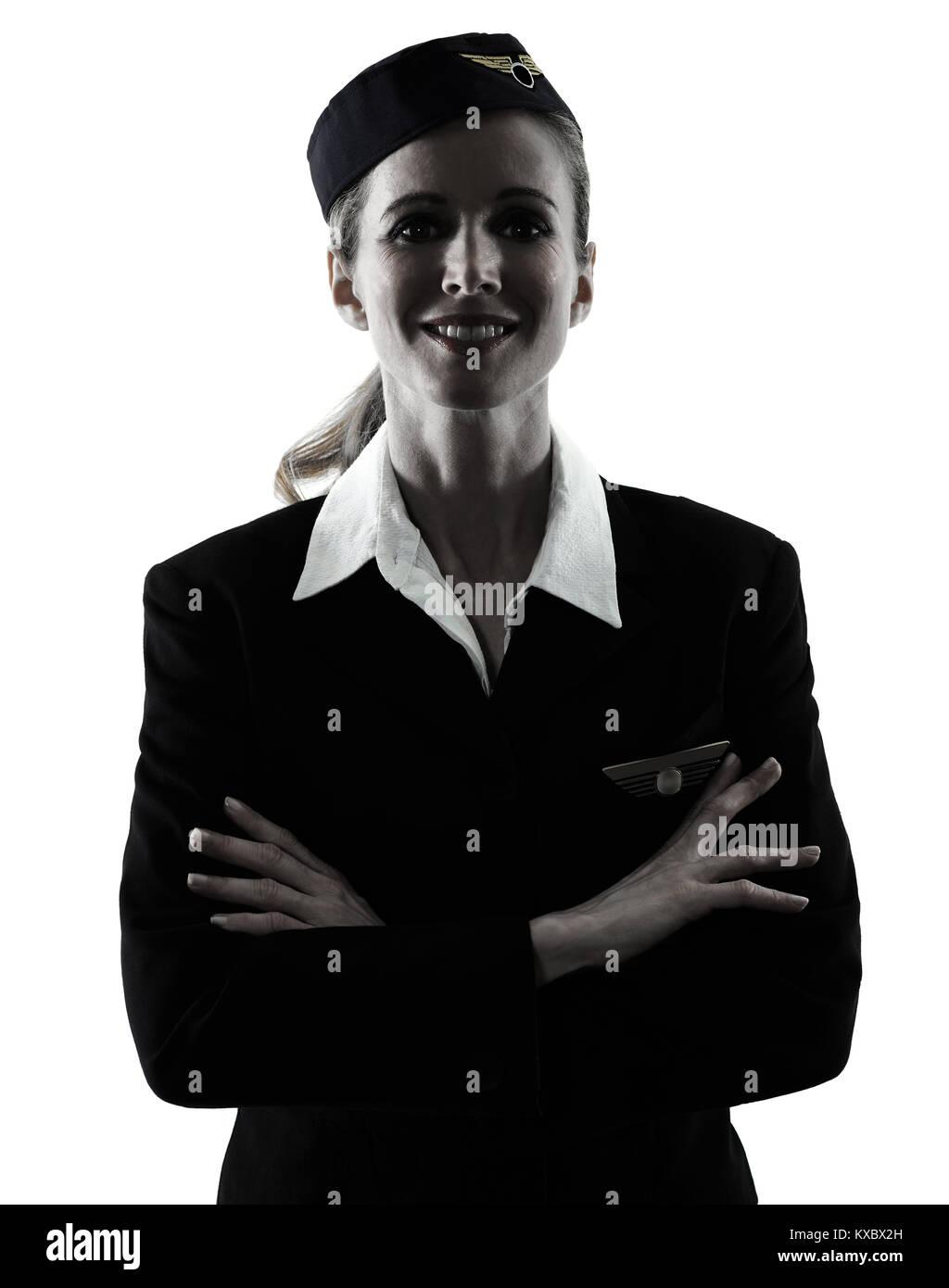 Una azafata caucásica CABIN CREW Mujer de pie aislado sobre fondo blanco en silueta Imagen De Stock