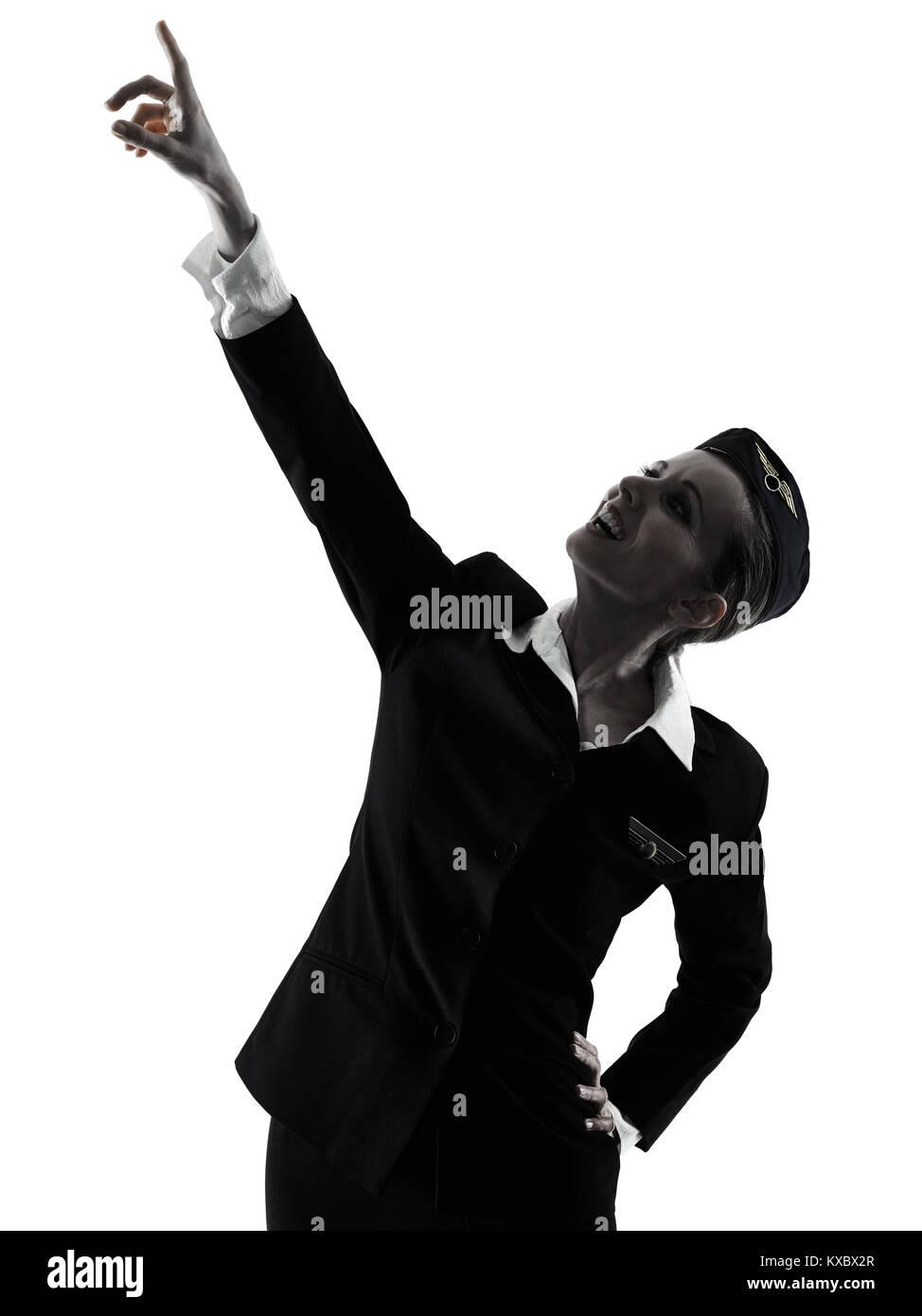 Una azafata caucásica CABIN CREW mujer señalando mostrando aislado sobre fondo blanco en silueta Imagen De Stock
