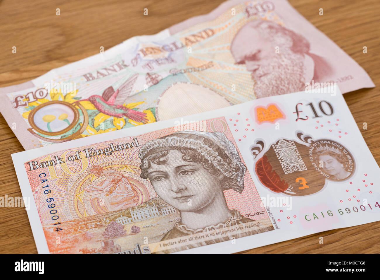 Una nueva nota de polímero de diez libras con Jane Austen superponer un viejo papel de diez libras nota con Imagen De Stock