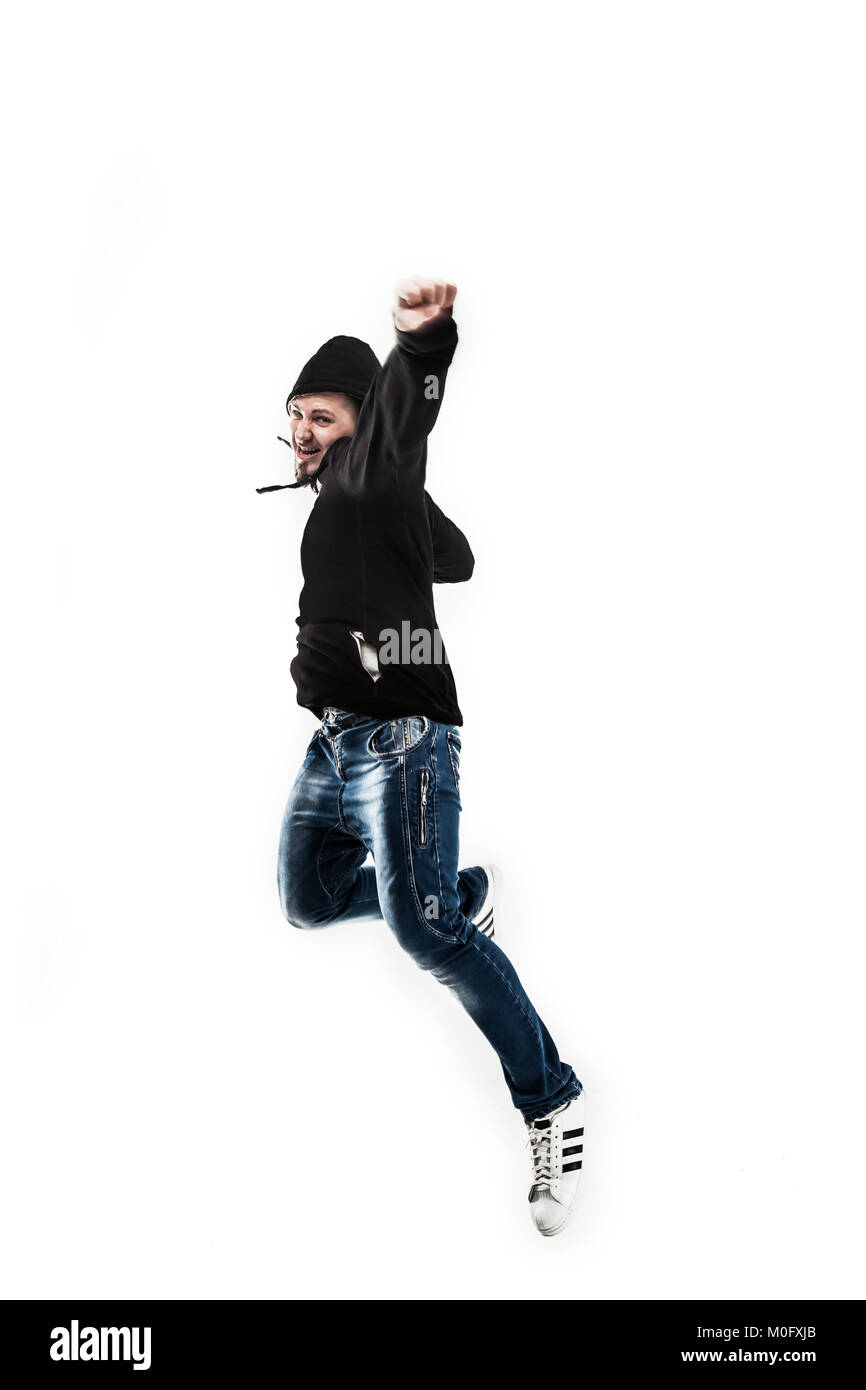 Enérgico y carismático guy rapper baila break dance. Imagen De Stock