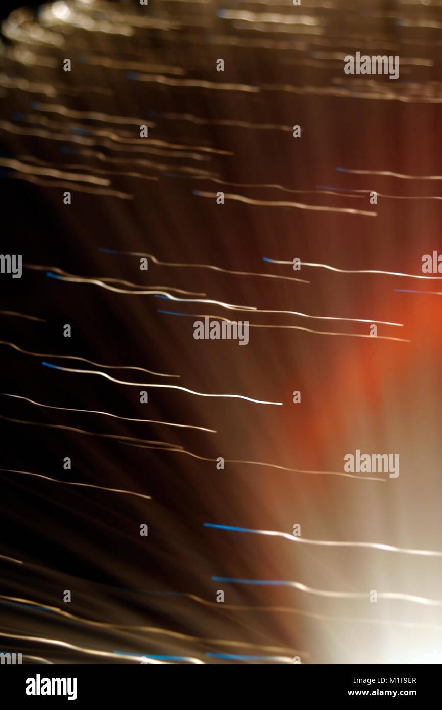 Lámparas de fibra óptica, abstracto multicolor sobre fondo negro Imagen De Stock