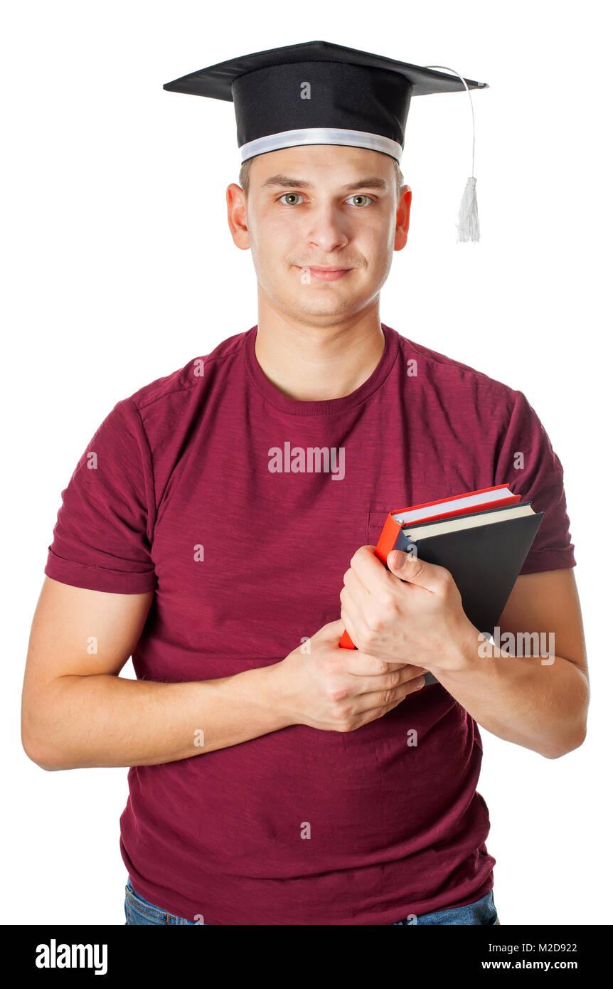 e3333177e Apuesto joven vestidos de graduación de la tapa y la celebración de libros  sobre fondo aislado