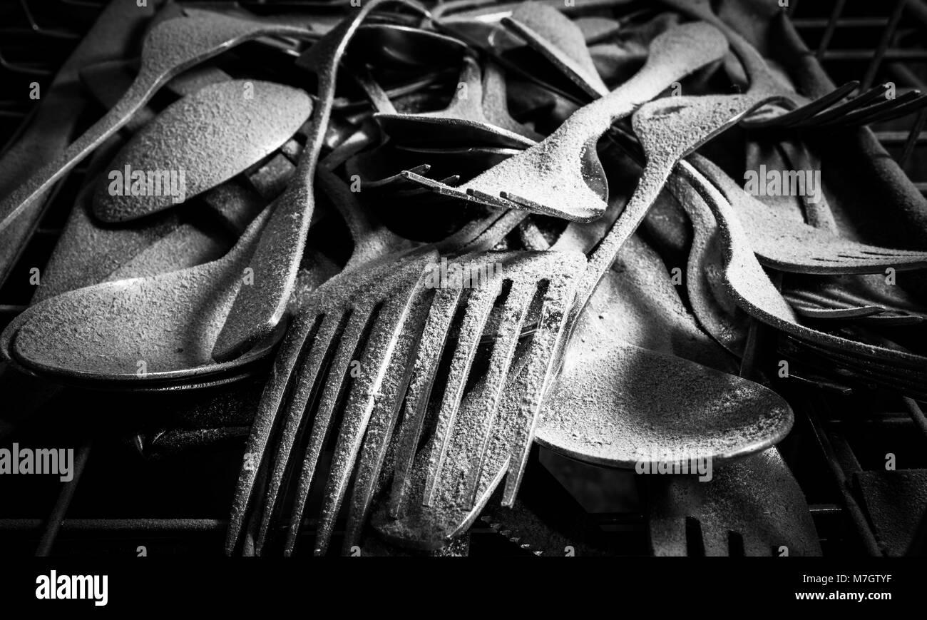 Cubiertos de polvo Foto de stock