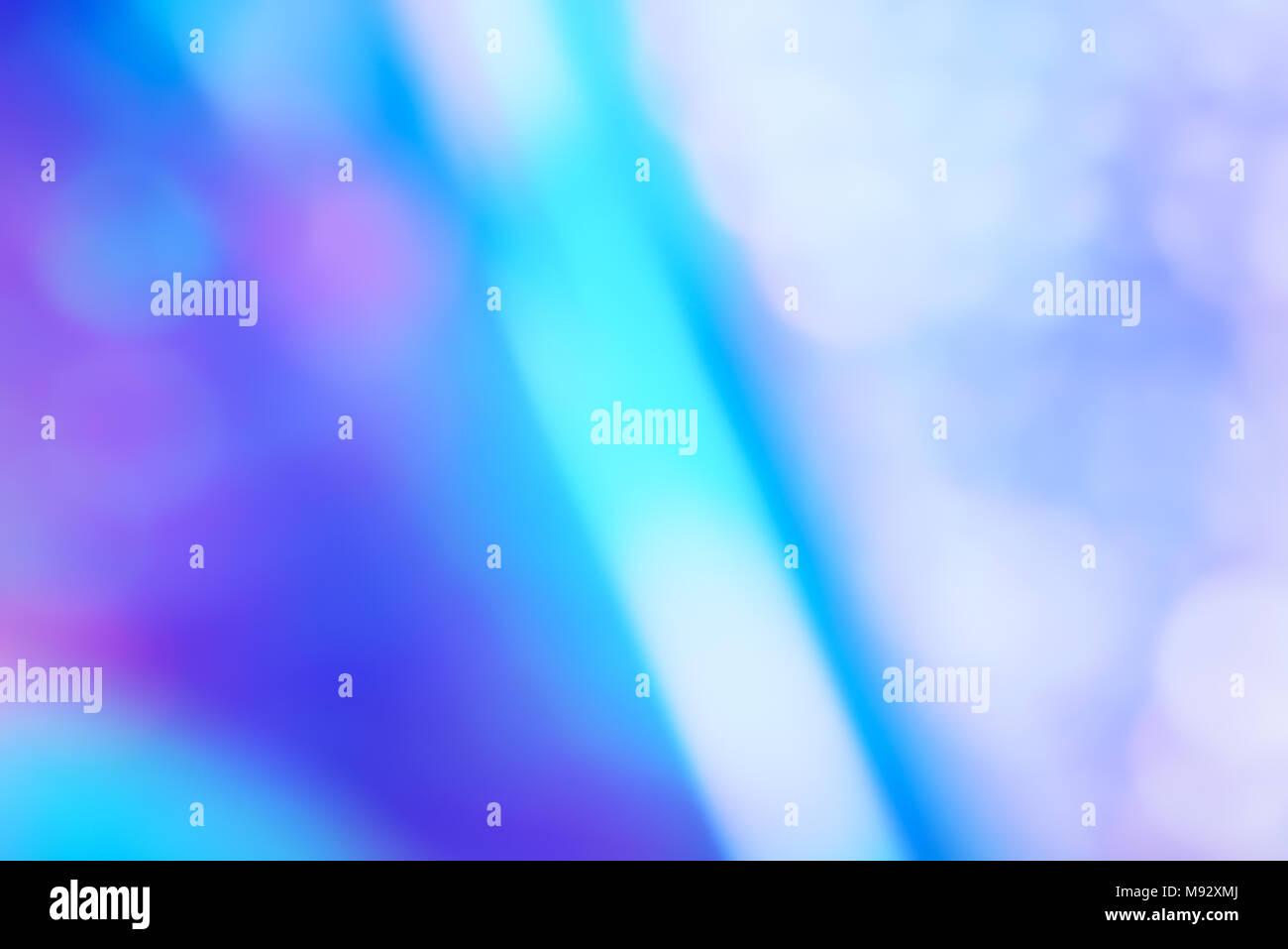 Resumen de neón ultravioleta unfocus holográfico con luz efecto bokeh de fondo. Foto de stock
