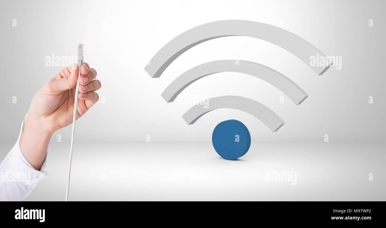 Mano sujetando el cable con conexión wi-fi icon Imagen De Stock