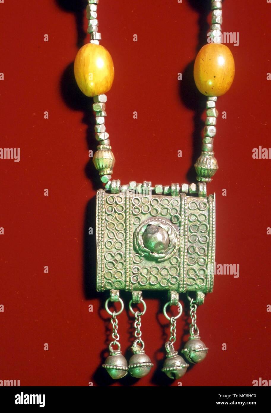 Amuletos - caso de amuleto, desde Oriente Medio, colección privada. Foto de stock
