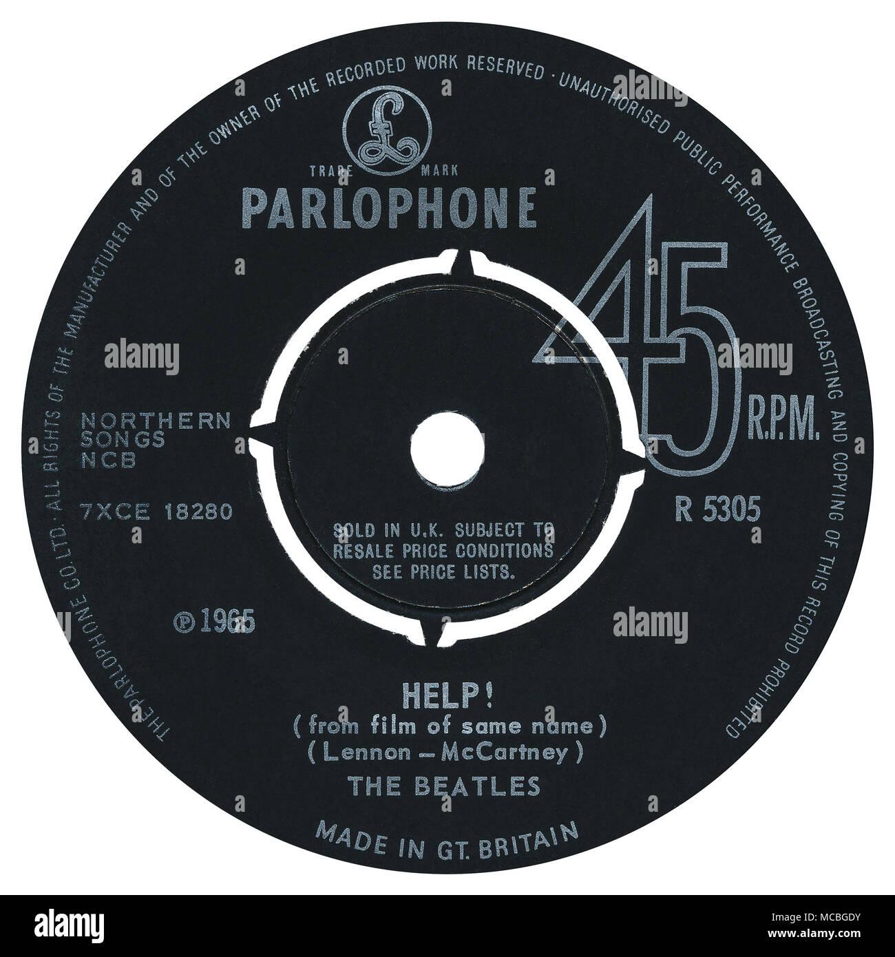 45 RPM 7' discográfica británica de ayuda! Por los Beatles en Parlophone Records desde 1965. Escrito por John Lennon y Paul McCartney y producido por George Martin. Imagen De Stock