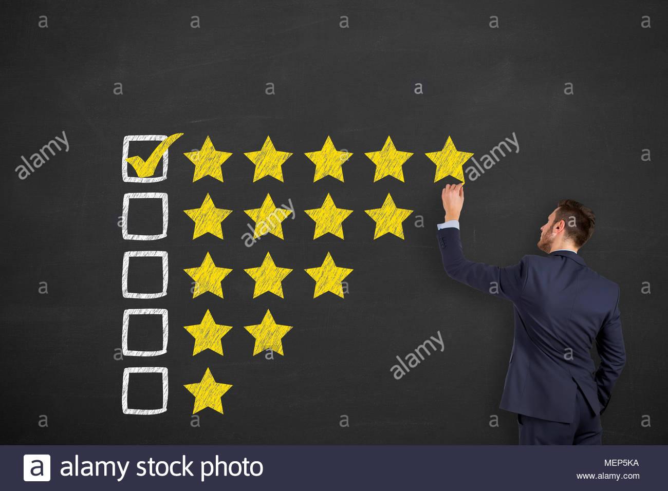 Satisfacción del cliente los conceptos sobre fondo de pizarra Imagen De Stock