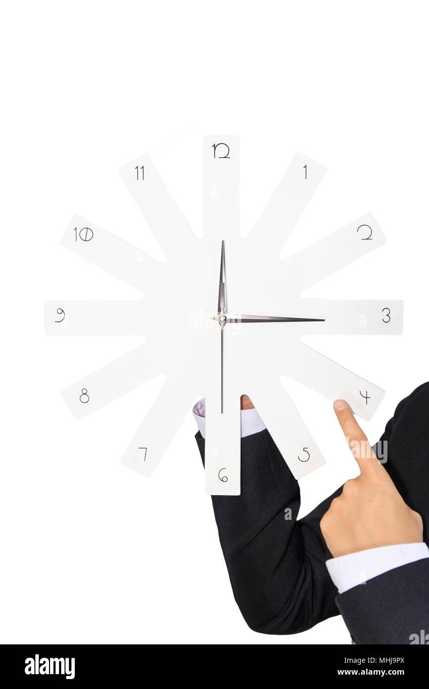 Empresario sosteniendo un reloj blanco Imagen De Stock