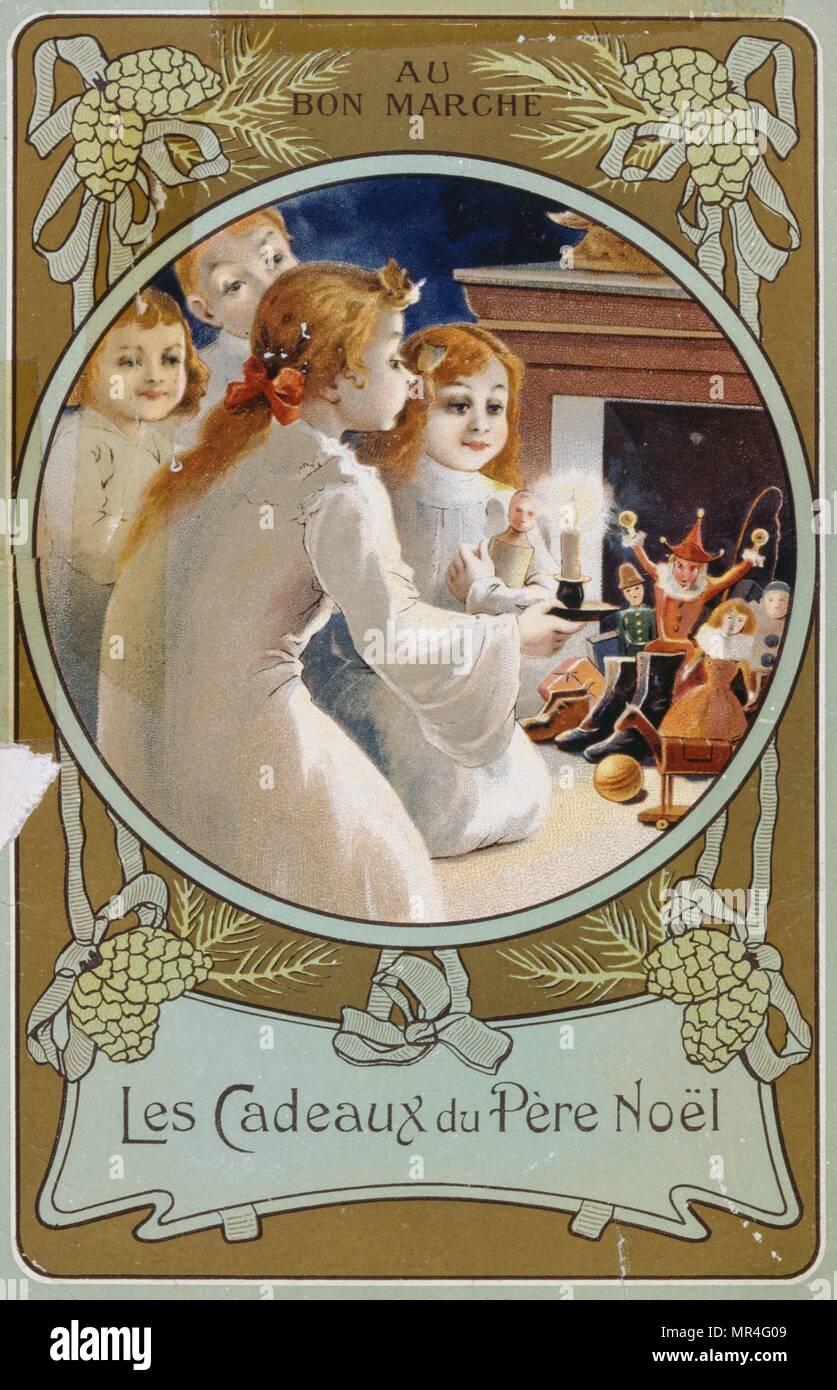 Tarjeta de Navidad francesa mostrando las niñas con una vela en la víspera de Navidad. 1900 Imagen De Stock