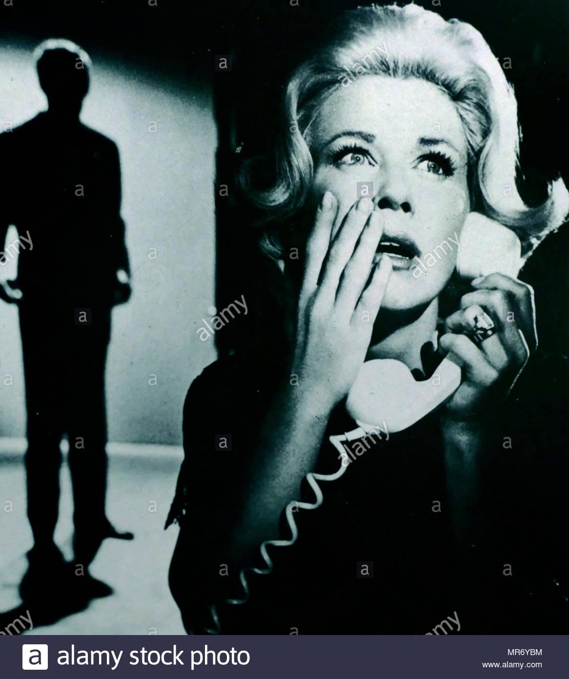 Es un encaje de medianoche 1960 American Eastmancolor misterio thriller película dirigida por David Miller protagonizada por Doris Day y Rex Harrison. El guión por Ivan Goff y Ben Roberts está basado en el juego de Matilda gritó fuego por Janet Green. Imagen De Stock