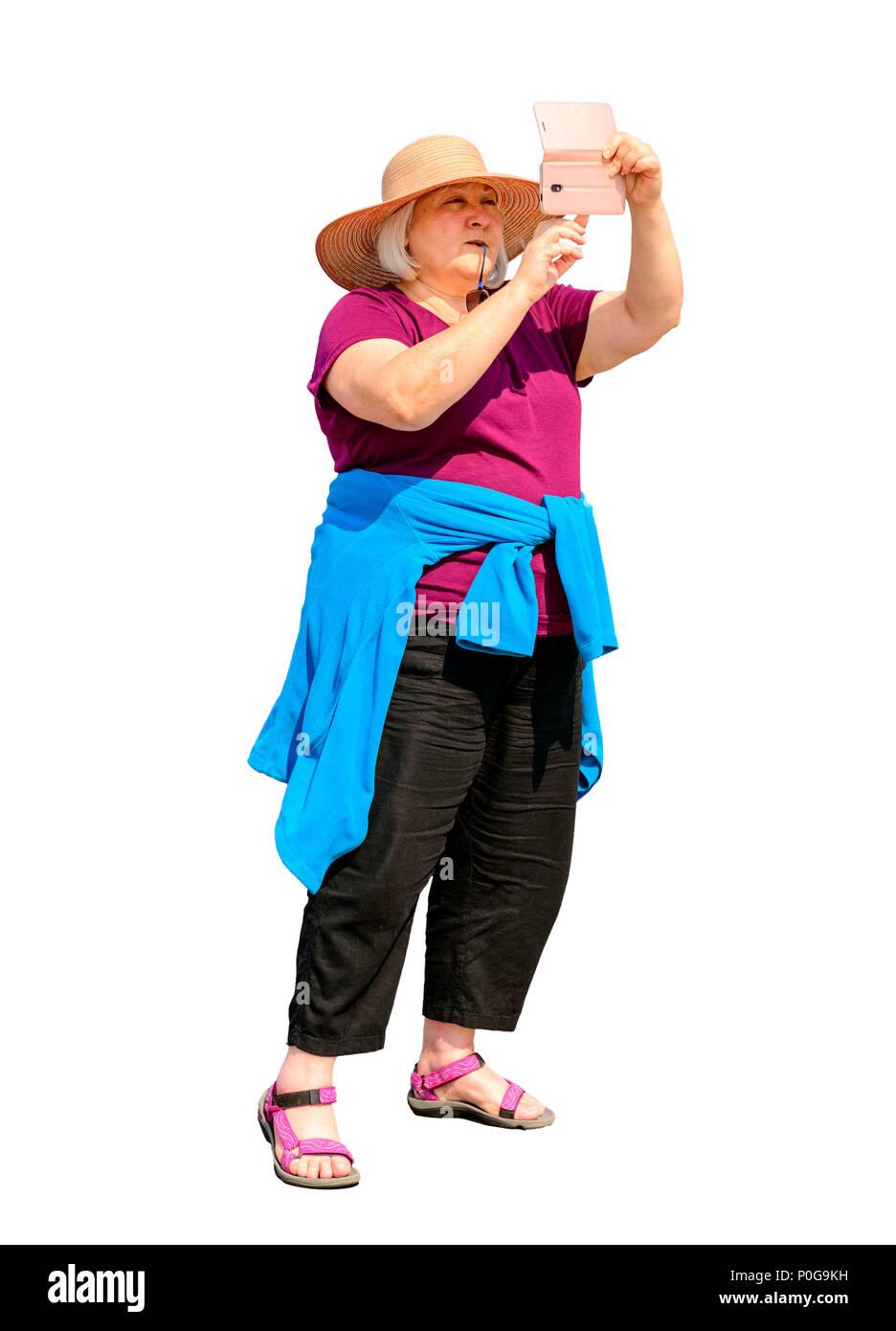 Mujer de mediana edad teniendo un selfie en Eastbourne pier Imagen De Stock