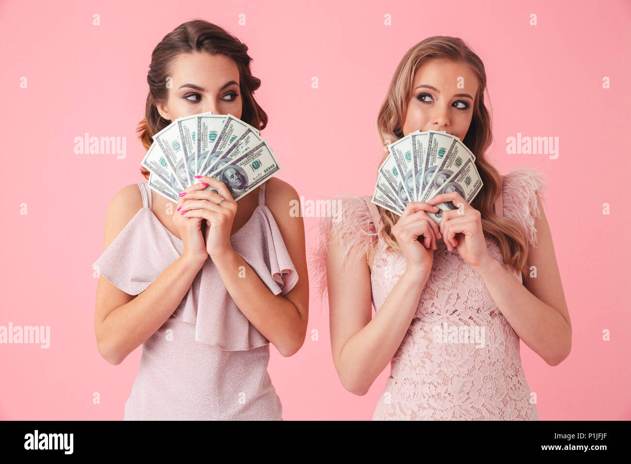 Two Women With Fancy Dresses Imágenes De Stock & Two Women With ...