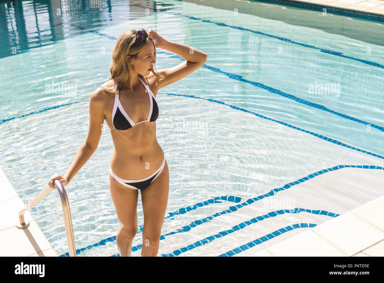 a4236fcfef8c Bikini Girl Standing Wearing Sunglasses Imágenes De Stock & Bikini ...