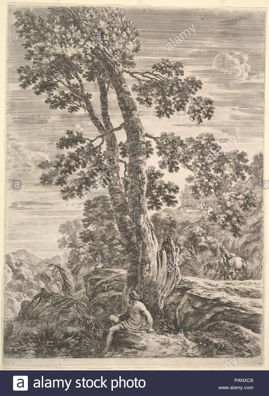 Un pescador en el centro hacia la izquierda y apoyado contra un árbol  grande f3823ae3152