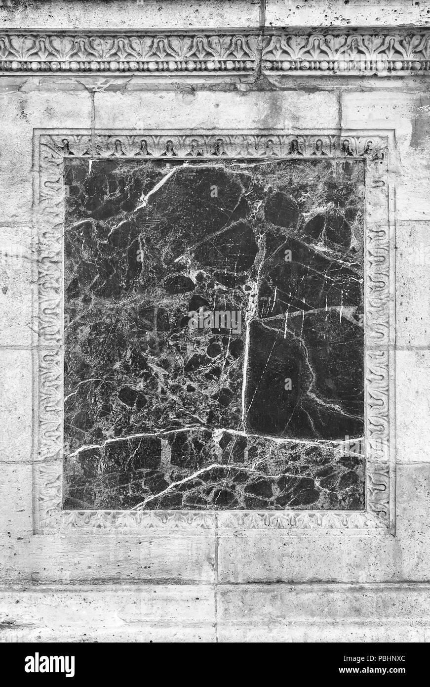 Inserto de mármol de un antiguo muro. Foto de stock