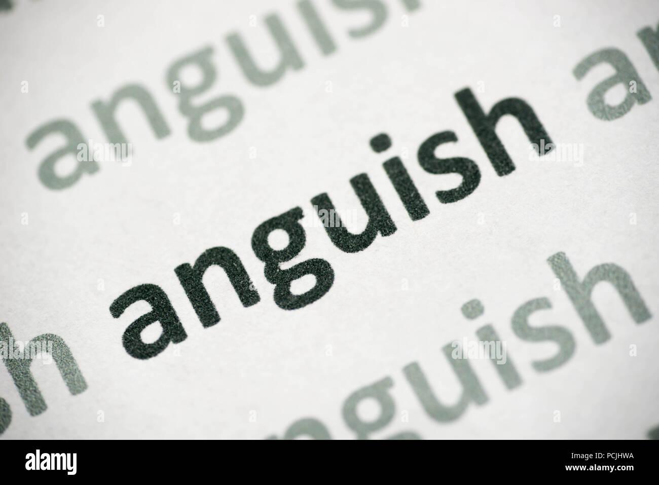 Palabra angustia impreso en papel blanco macro Imagen De Stock