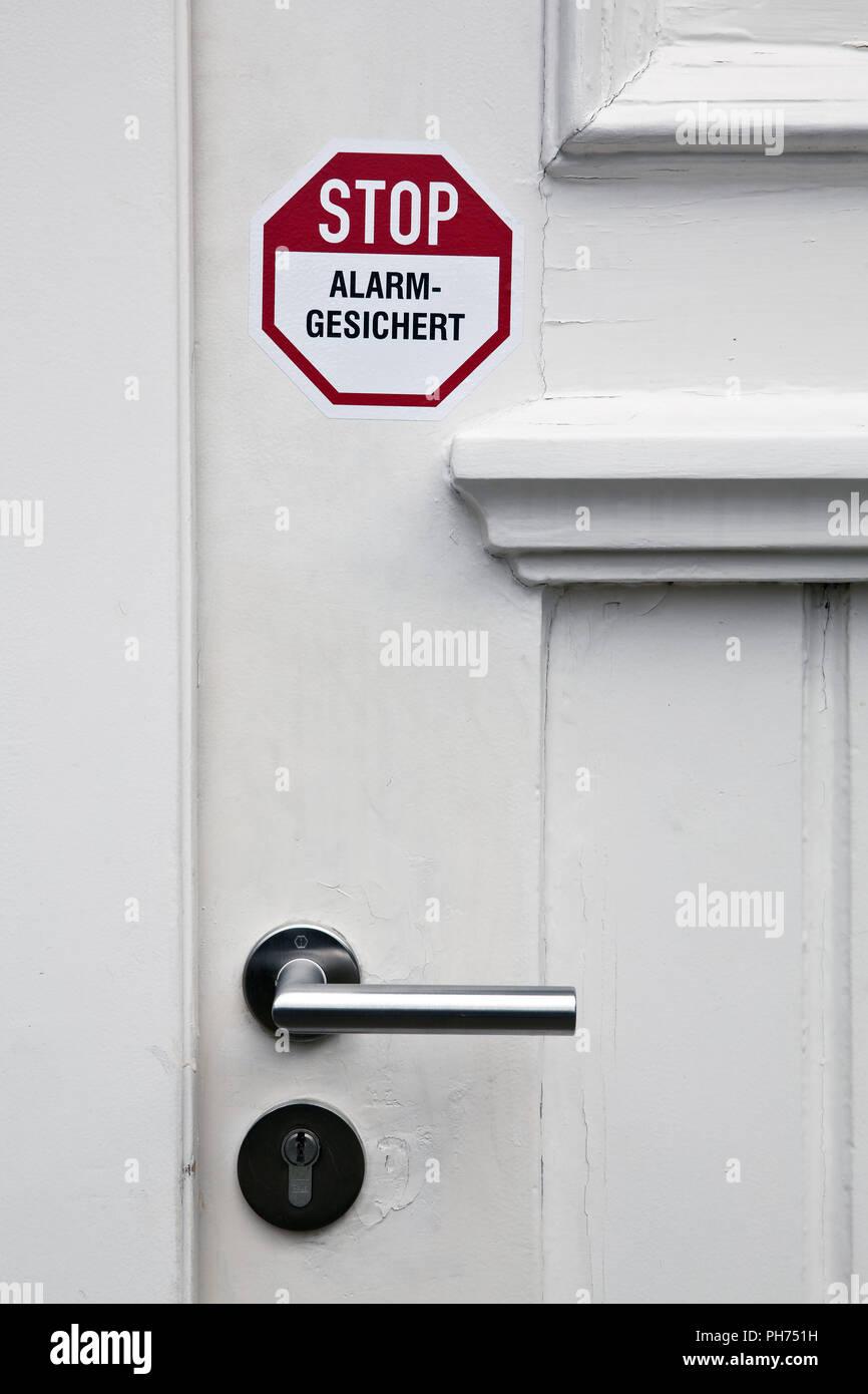 Adhesivo en la puerta la alarma de parada Foto de stock