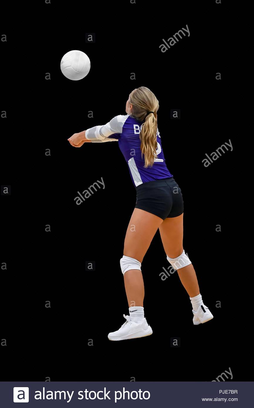 Niñas de escuela secundaria que compiten en los juegos de voleibol Imagen De Stock