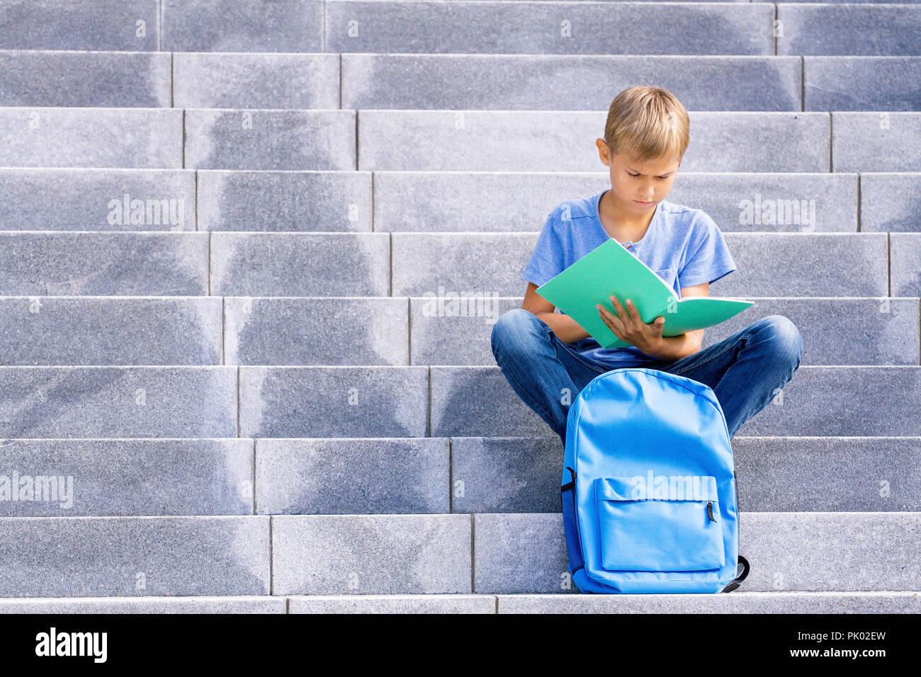 37fa995c5 School Kids Sitting On Stairs Imágenes De Stock & School Kids ...