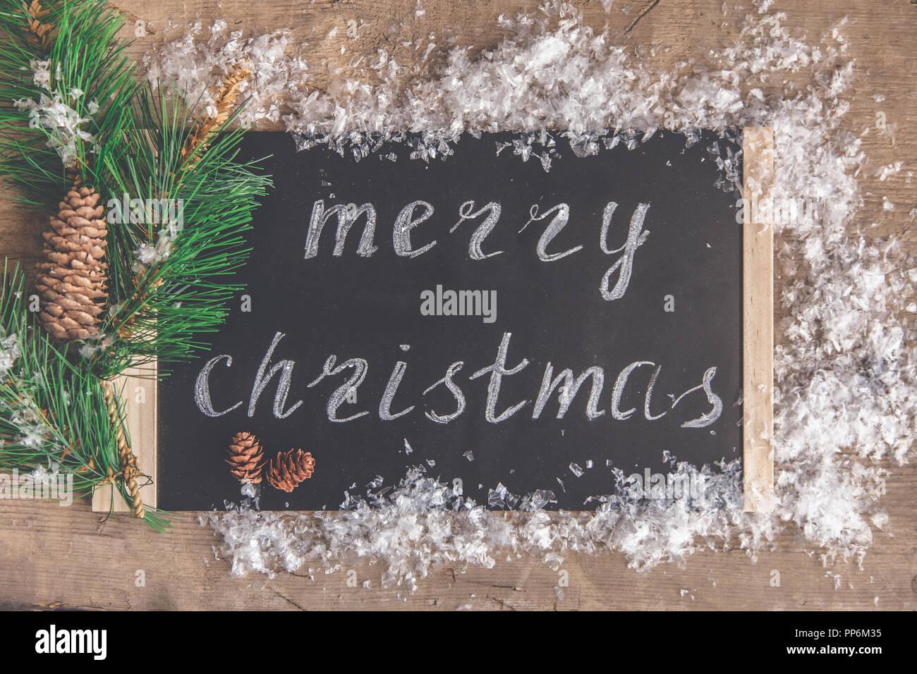Navidad y Año Nuevo concepto. Firma con la inscripción Feliz Navidad vista superior Imagen De Stock