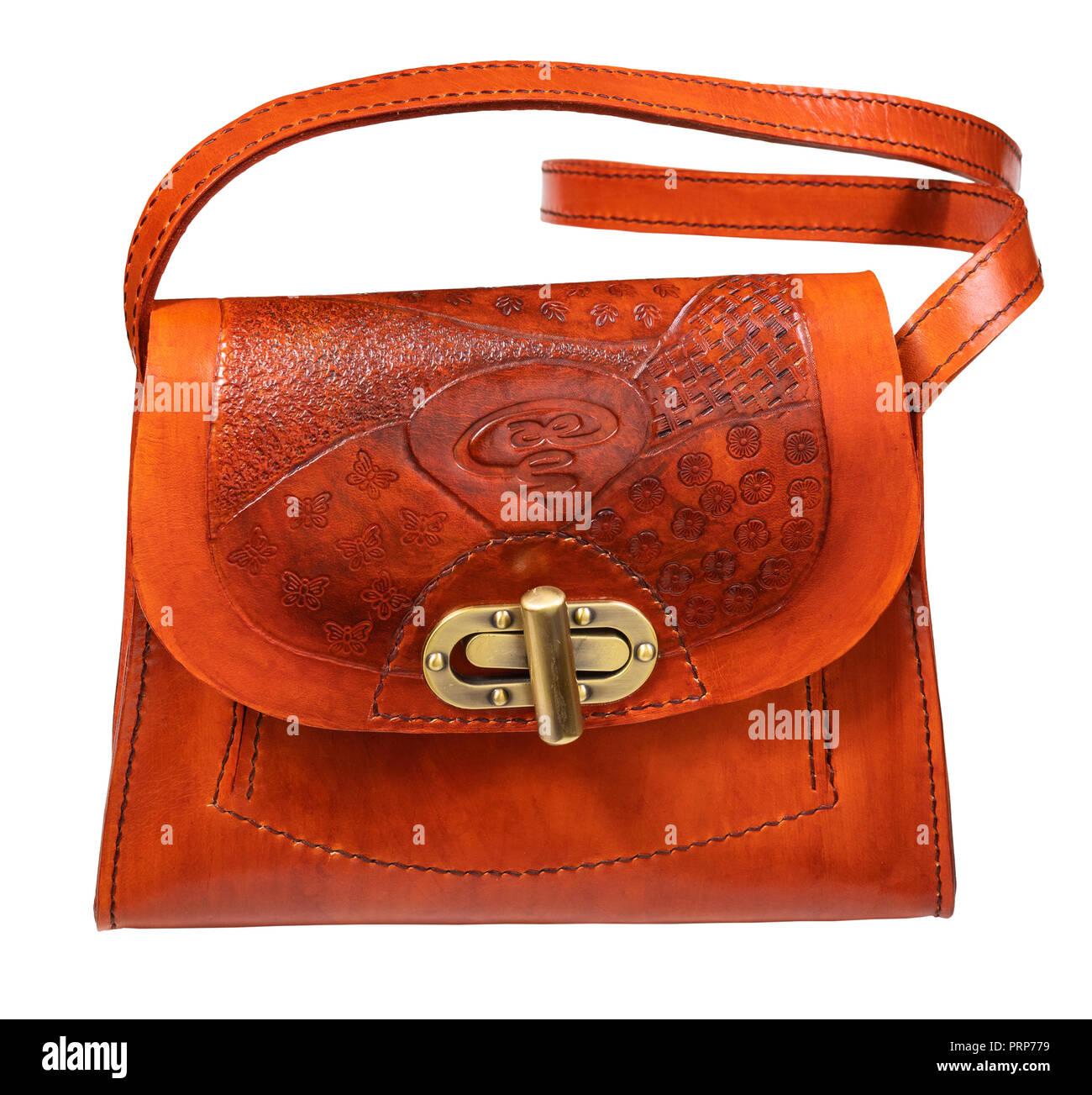 c5d3d0943 Hechos a mano de color naranja bolso de cuero repujado recorte sobre fondo  blanco.