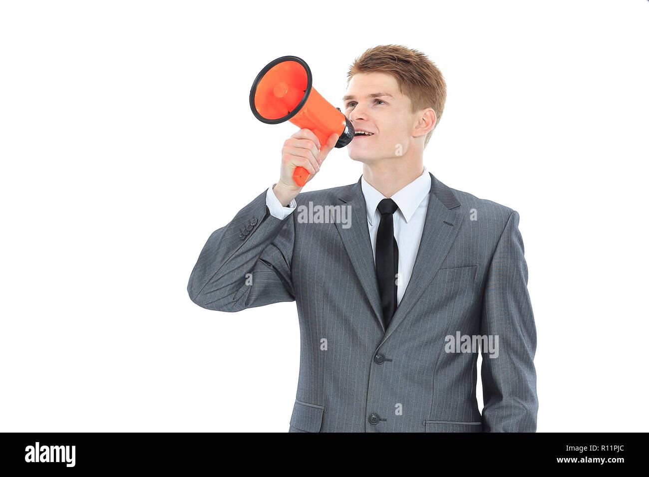 Empresario joven con un megáfono.aislados en un blanco Imagen De Stock