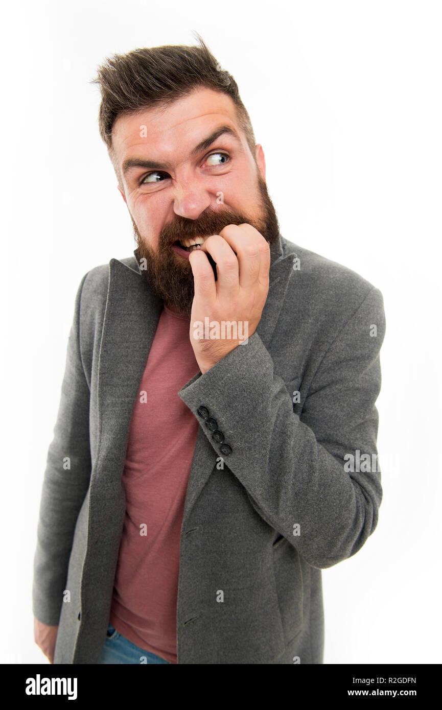 El hombre barbado hipster dudoso cara dedo mientras muerde el pensamiento. Tomar decisión nervioso. Hipster nervioso brutal expresión de cara pensativa. Decisión nervioso concepto. Nervioso acerca de la solución de problemas. Imagen De Stock