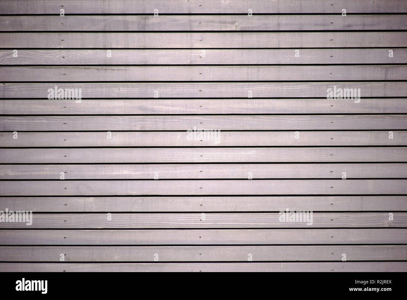 Cerca de los paneles de madera de una pared hecha de paneles de madera, Imagen De Stock