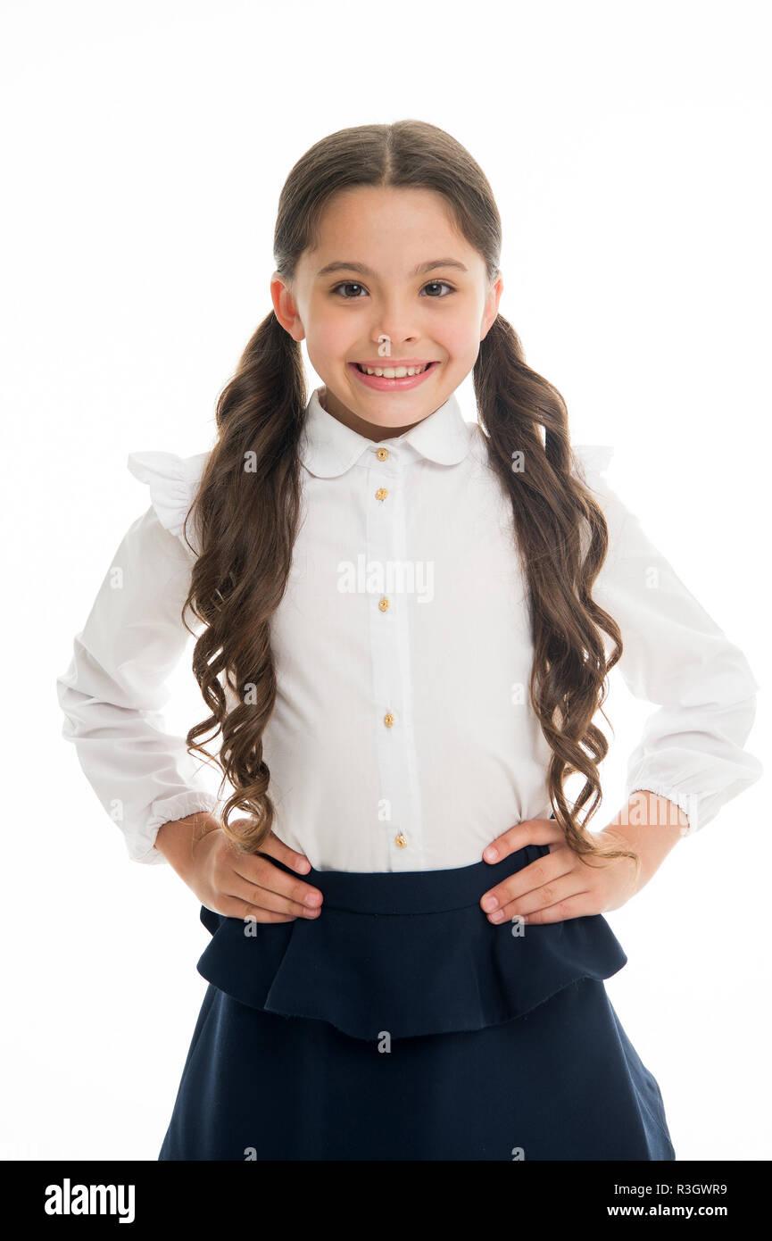 Lindo y divertido peinados para hacer brillar en su primera semana de regreso en la escuela. Preciosas colas perfectas para cada día de la semana. Alumna pupila largo rizado Imagen De Stock