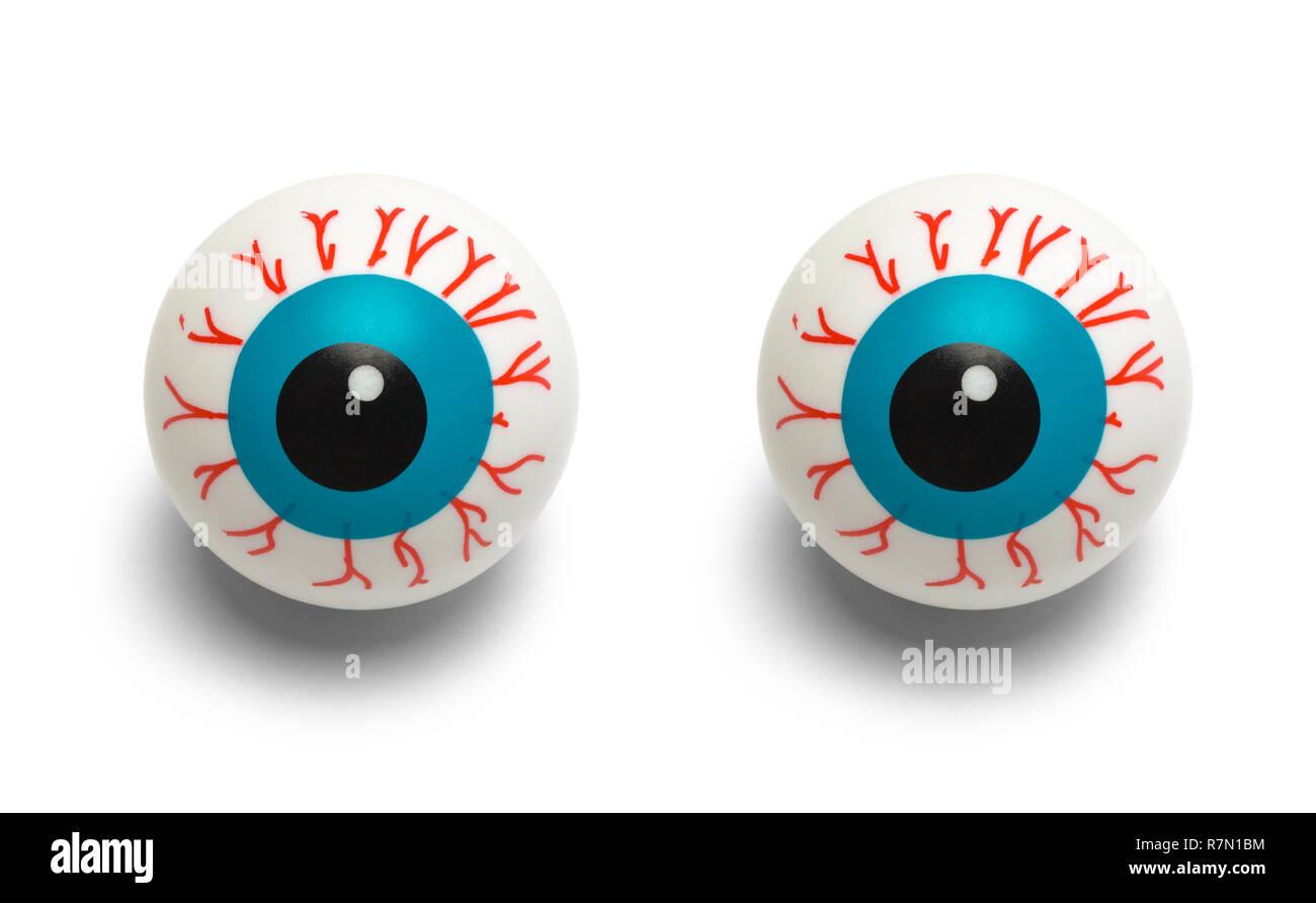 Dos Ojos inyectados de sangre de plástico aislado sobre fondo blanco. Imagen De Stock