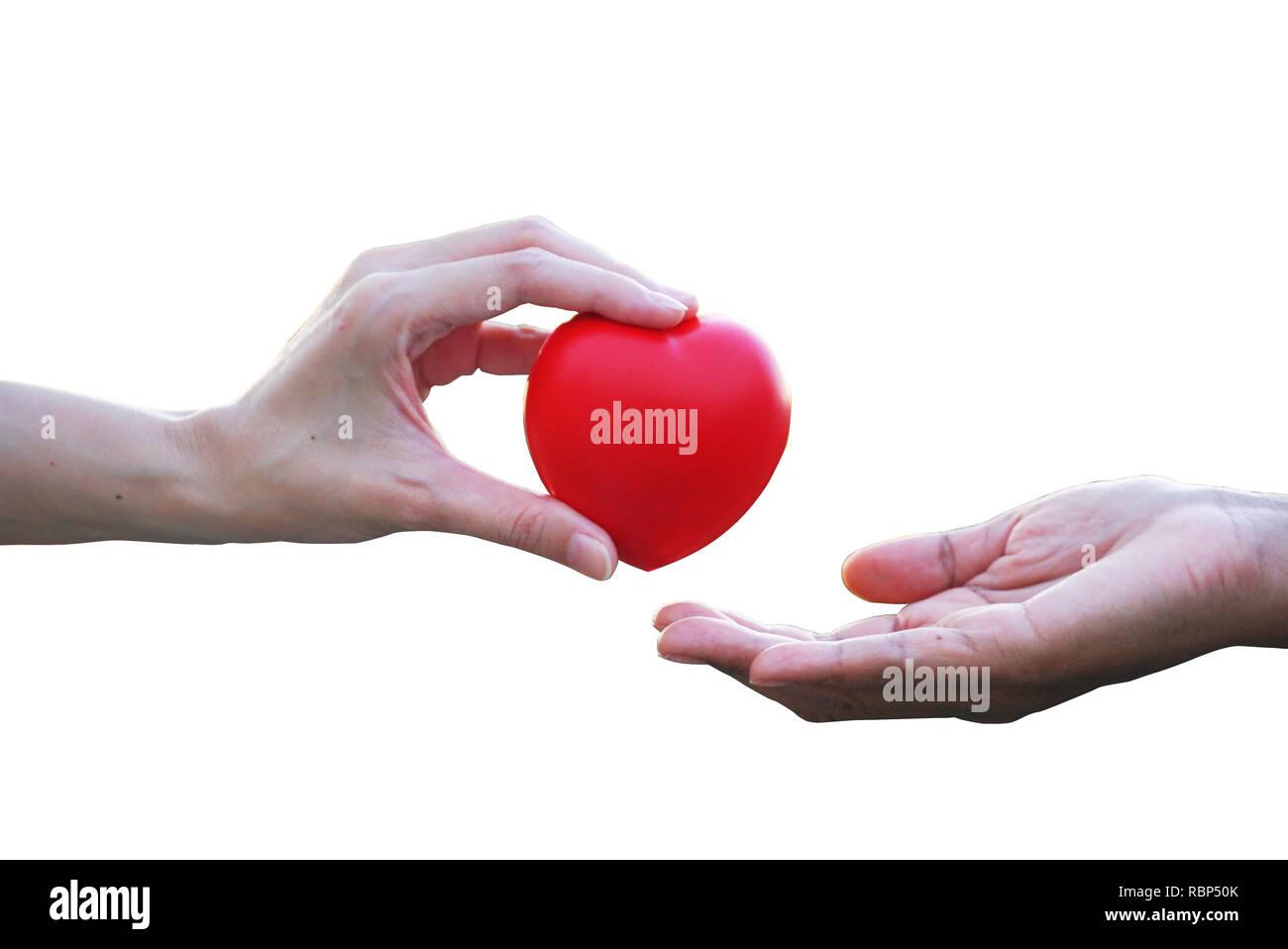 Amigo 's mano dar corazón rojo para alentar perdedor con fondo blanco. Imagen De Stock