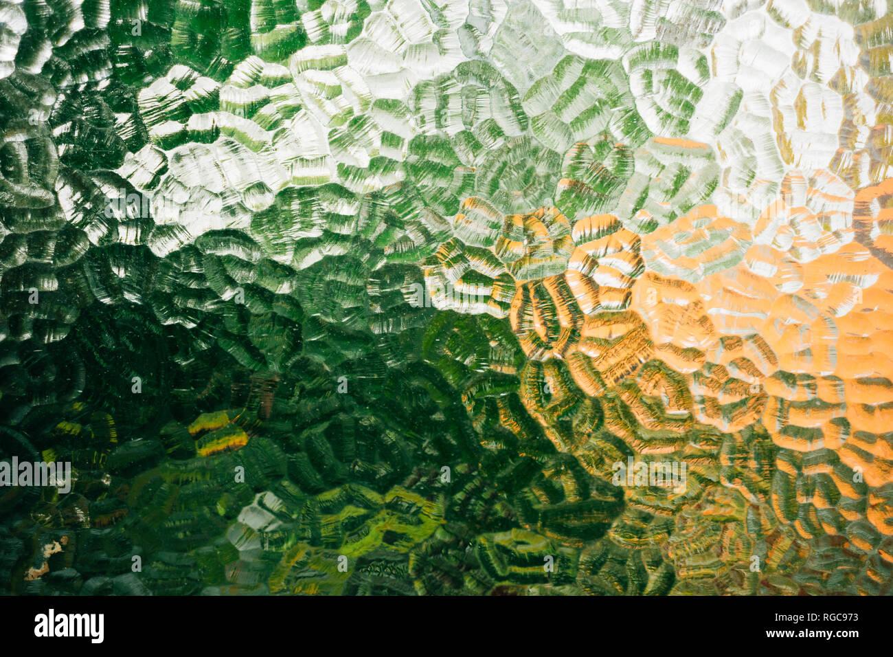 Ventana de cristal con texturas y colores verde y naranja Imagen De Stock