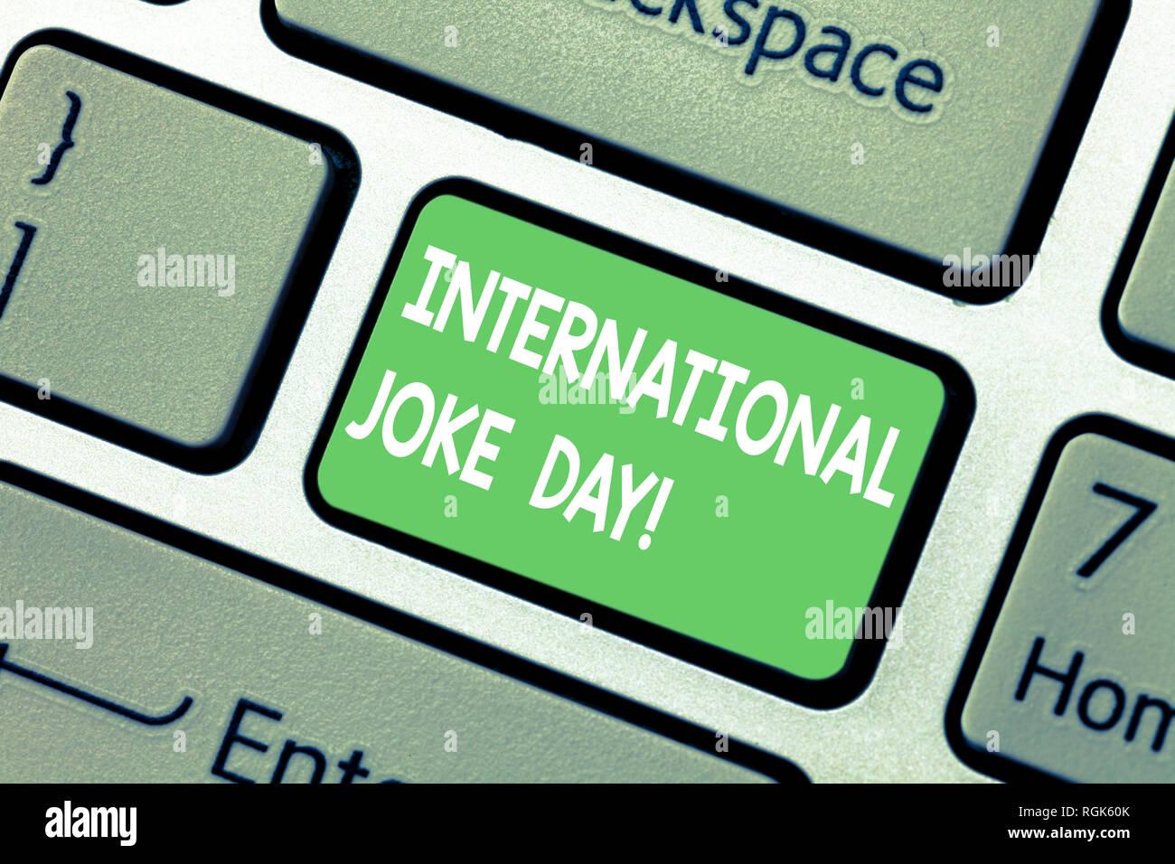 Escritura de texto Word broma del día internacional. Concepto de negocio para vacaciones para celebrar el beneficio de buen humor tecla intención crear compute Imagen De Stock